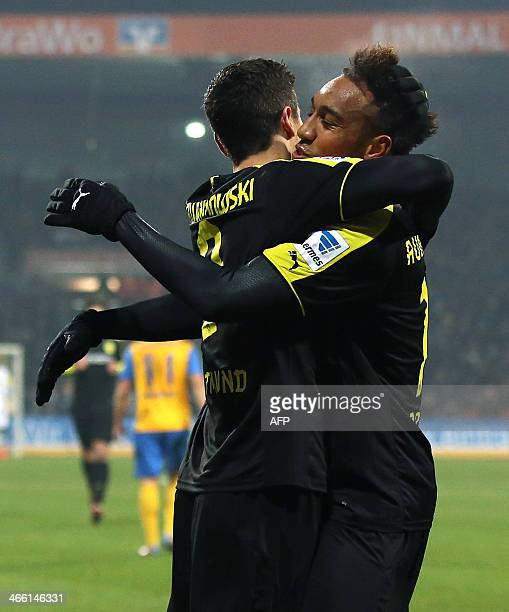 Dortmund's Polish striker Robert Lewandowski and Dortmund's Gabonese striker PierreEmerick Aubameyang celebrate their teams first goal during the...