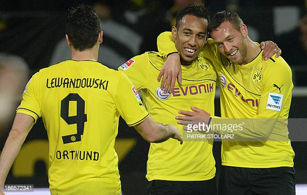 Dortmund's Polish striker Robert Lewandowski Gabonese striker PierreEmerick Aubameyang and Dortmund's striker Julian Schieber celebrate during the...