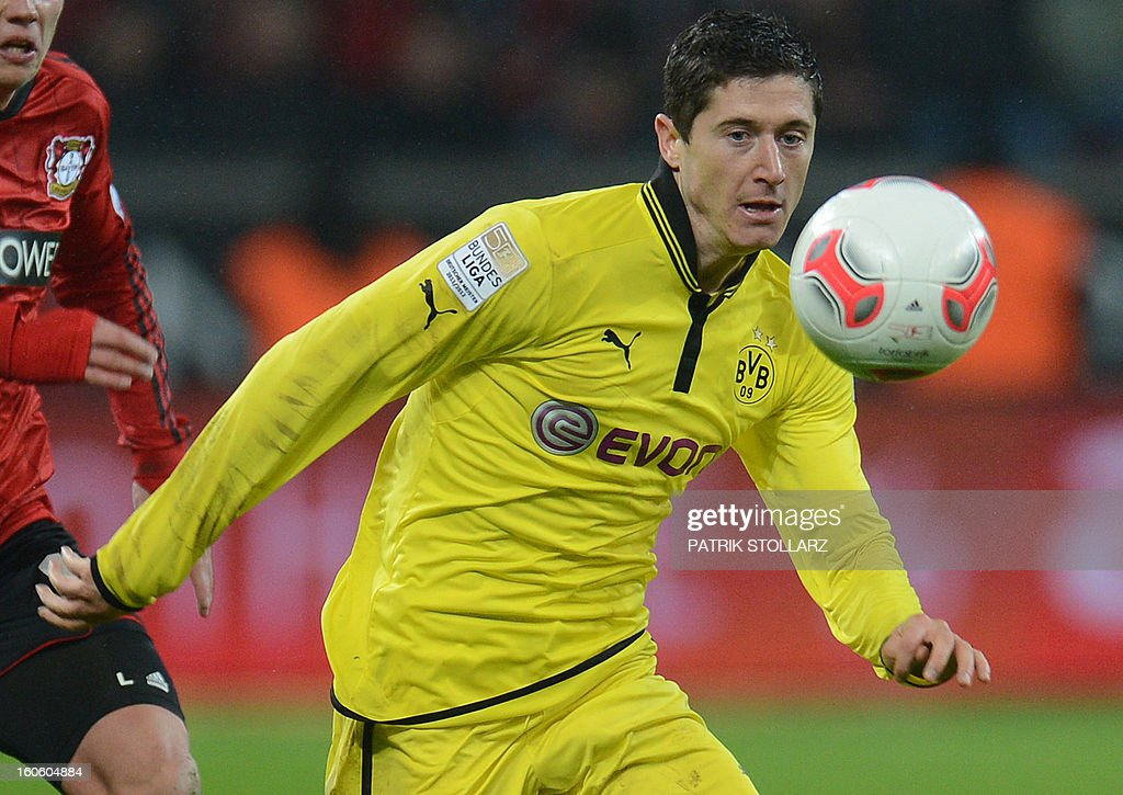 Dortmund's Polish striker Robert Lewandowski plays the ball during the German first division Bundesliga football match Bayer Leverkusen vs Borussia Dortmund in the western German city of Leverkusen on February 3, 2013. Dortmund won the match 2-3.