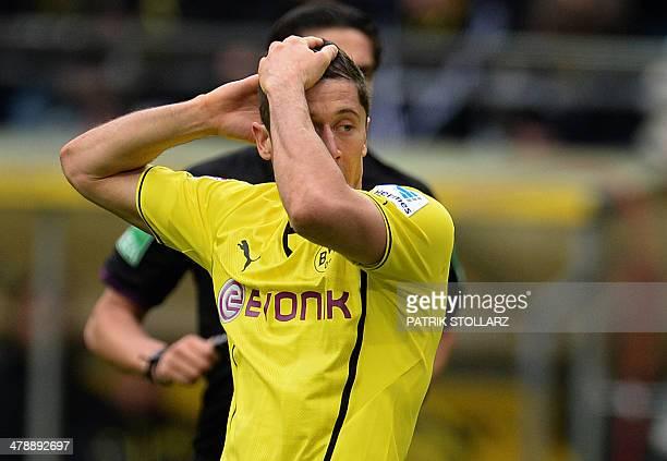 Dortmund's Polish striker Robert Lewandowski reacts during the German first division Bundesliga football match Borussia Dortmund vs Borussia...