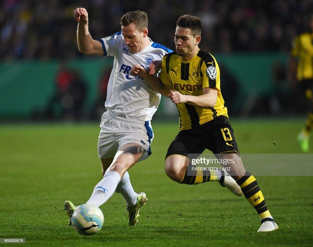 Dortmund s Portuguese defender Raphael Guerreiro R and Lotte´s