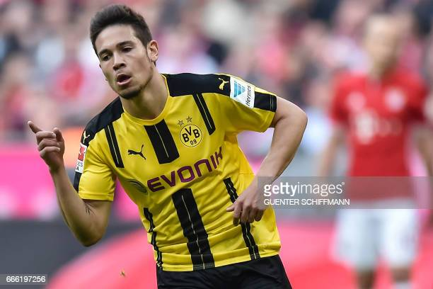 Dortmund's Portuguese defender Raphael Guerreiro celebrate scoring the 21 goal during the German first division Bundesliga football match FC Bayern...