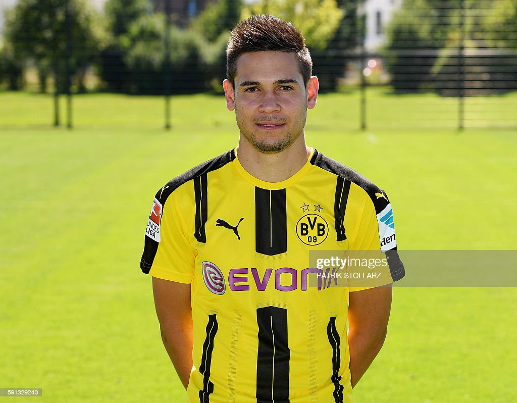 Dortmund s Portuguese defender Raphael Guerreiro poses during the