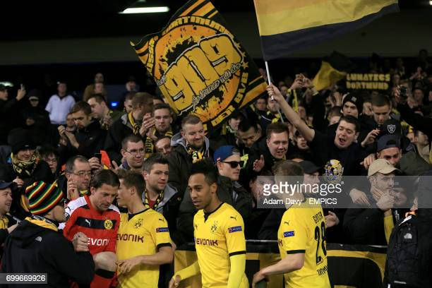 Dortmund's Roman Weidenfeller Julian Weigl PierreEmerick Aubameyang and Matthias Ginter celebrate with the fans in the stands after the final whistle