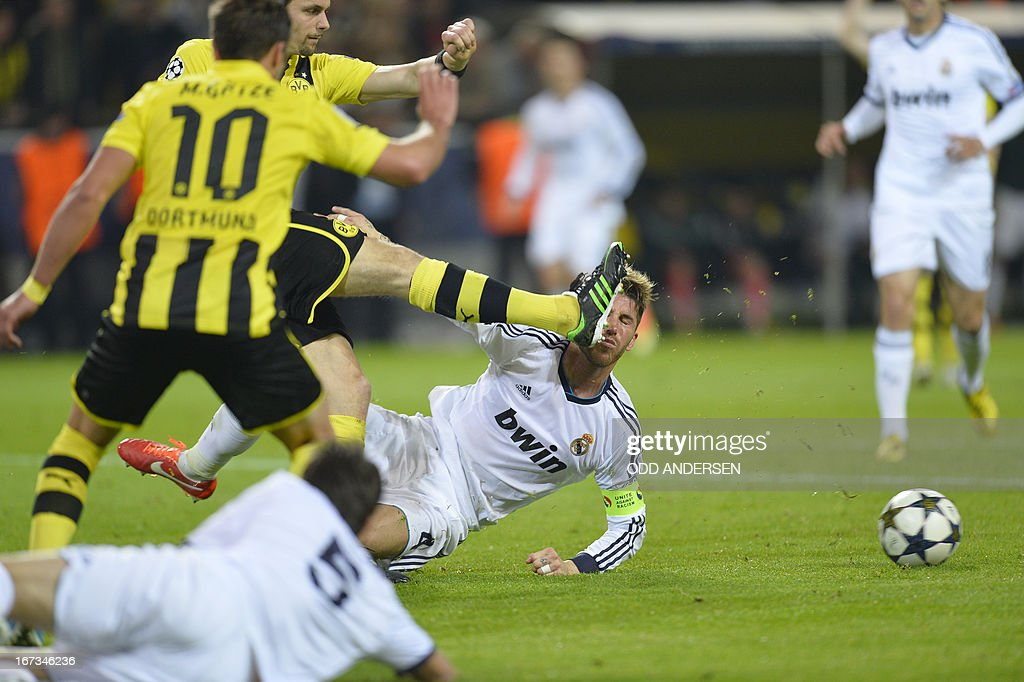 Dortmund's Serbian defender Neven Subotic (L) catches Real Madrid's defender Sergio Ramos (R) with his foot during the UEFA Champions League semi final first leg football match between Borussia Dortmund and Real Madrid on April 24, 2013 in Dortmund, western Germany. Dortmund won 4:1. ANDERSEN