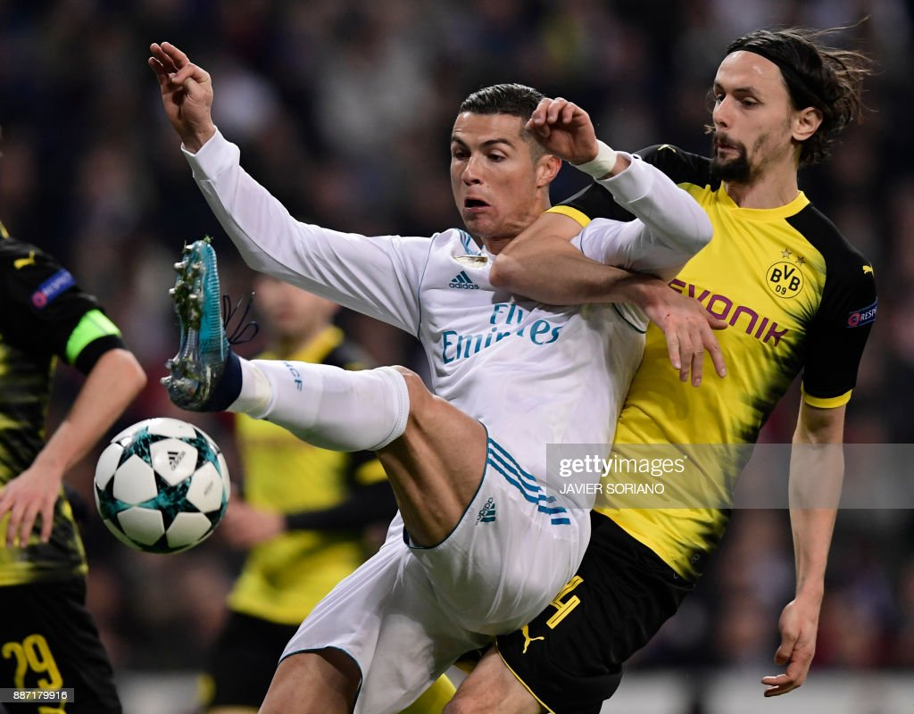Dortmund's Serbian defender Neven Subotic (R) vies with Real Madrid's Portuguese forward Cristiano Ronaldo during the UEFA Champions League group H football match Real Madrid CF vs Borussia Dortmund at the Santiago Bernabeu stadium in Madrid on December 6, 2017. /