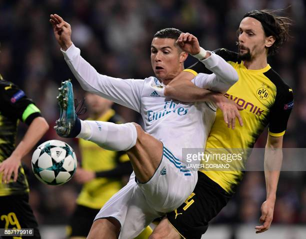 Dortmund's Serbian defender Neven Subotic vies with Real Madrid's Portuguese forward Cristiano Ronaldo during the UEFA Champions League group H...