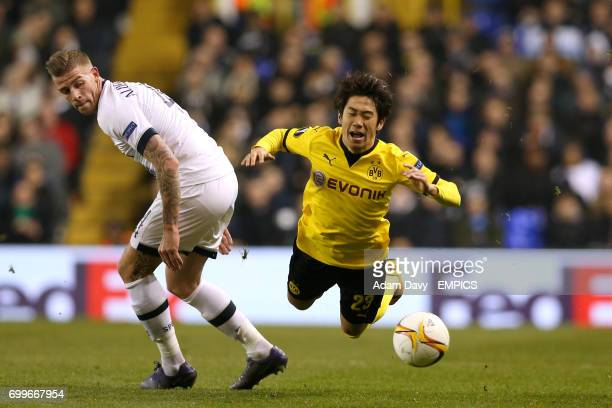 Dortmund's Shinji Kagawa goes down under a challenge from Tottenham Hotspur's Toby Alderweireld