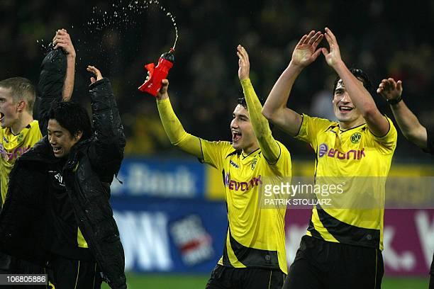 DFL Dortmund`s Shinji Kagawa Nuri Sahin and Mats Hummels celebrate after the German first division Bundesliga football match Borussia Dortmund vs...