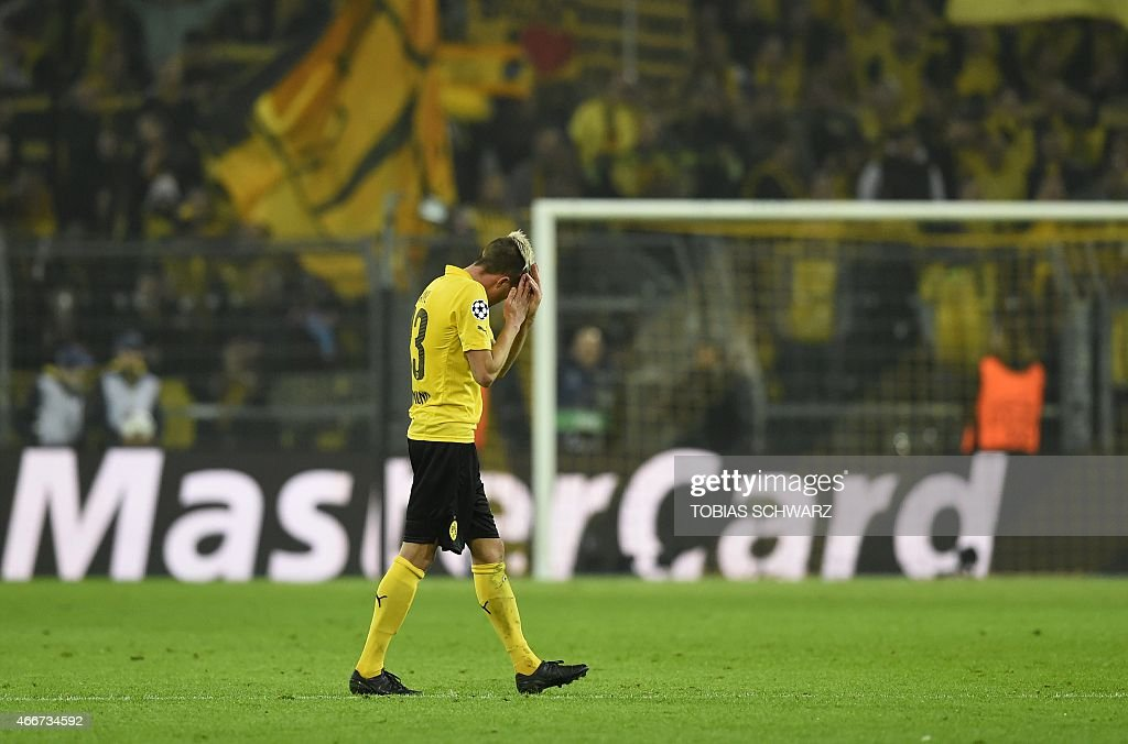 Dortmund's Slovenian midfielder <a gi-track='captionPersonalityLinkClicked' href=/galleries/search?phrase=Kevin+Kampl&family=editorial&specificpeople=6527116 ng-click='$event.stopPropagation()'>Kevin Kampl</a> reacts during the Round of 16, second-leg UEFA Champions League football match Borussia Dortmund vs Juventus in Dortmund, western Germany on March 18, 2015. AFP PHOTO / TOBIAS SCHWARZ