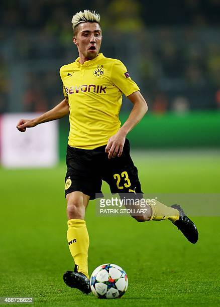 Dortmund's Slovenian midfielder Kevin Kampl runs with the ball during the Round of 16 secondleg UEFA Champions League football match Borussia...