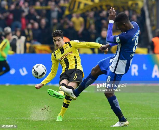 Dortmund's Spanish defender Marc Bartra and Hertha Berlin's Ivorian striker Salomon Kalou vie for the ball during the German First division...