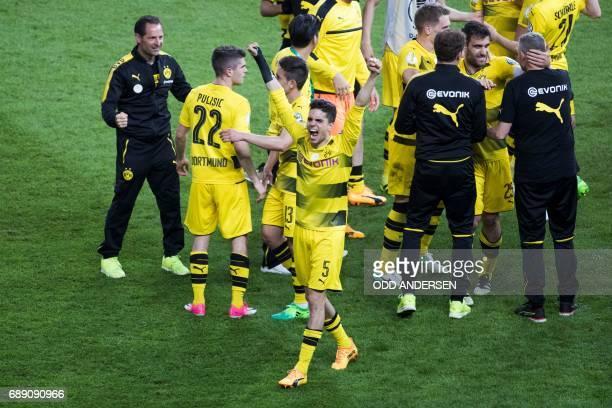 Dortmund's Spanish defender Marc Bartra and his teammates celebrate after the German Cup final football match Eintracht Frankfurt v BVB Borussia...