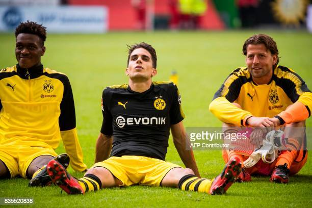 Dortmund´s Spanish defender Marc Bartra and team mates celebrate victory with their fans after the German First division Bundesliga football match...