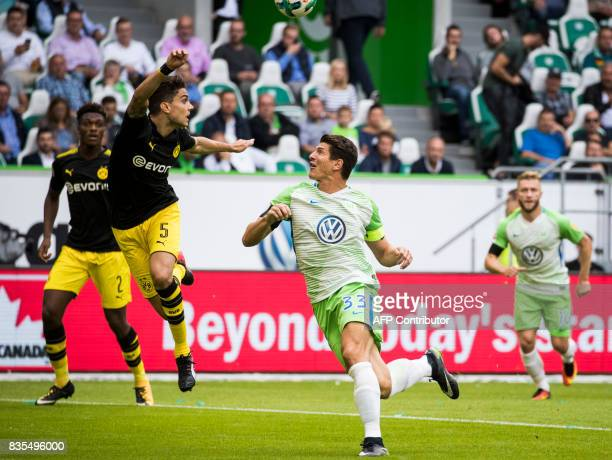Dortmund´s Spanish defender Marc Bartra and Wolfsburgs forward Mario Gomez vie for the ball during the German First division Bundesliga football...
