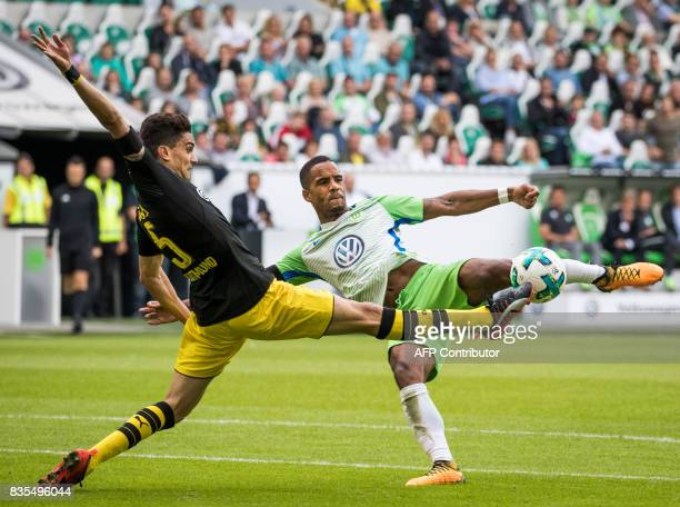 Dortmund´s Spanish defender Marc Bartra and Wolfsburg's midfielder Daniel Didavi vie for the ball during the German First division Bundesliga...