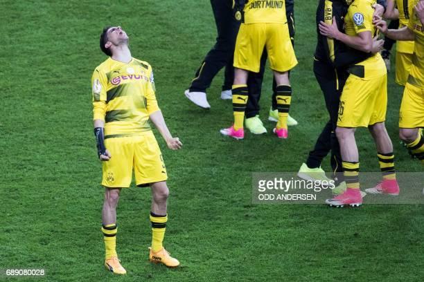 Dortmund's Spanish defender Marc Bartra celebrates after the German Cup final football match Eintracht Frankfurt v BVB Borussia Dortmund at the...