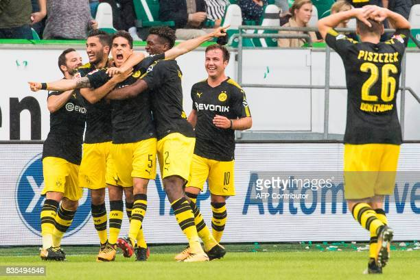 Dortmund´s Spanish defender Marc Bartra celebrates scoring his teams' second goal with team mates during the German first division Bundesliga...
