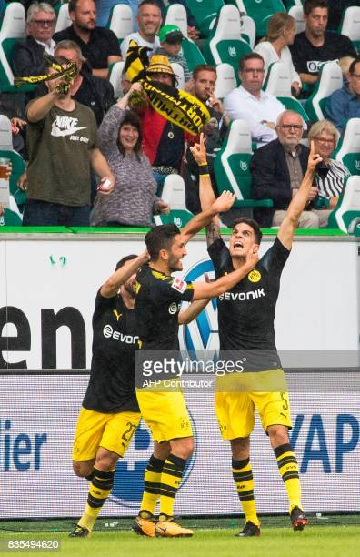 Dortmund´s Spanish defender Marc Bartra celebrates scoring his team's second goal with team mates during the German First division Bundesliga...