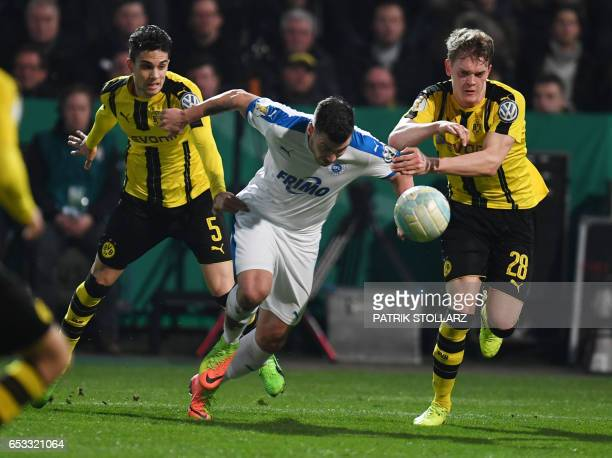 Dortmund's Spanish defender Marc Bartra Dortmund's defender Matthias Ginter and Lotte´s Jaroslaw Lindner vie for the ball during the German Cup DFB...