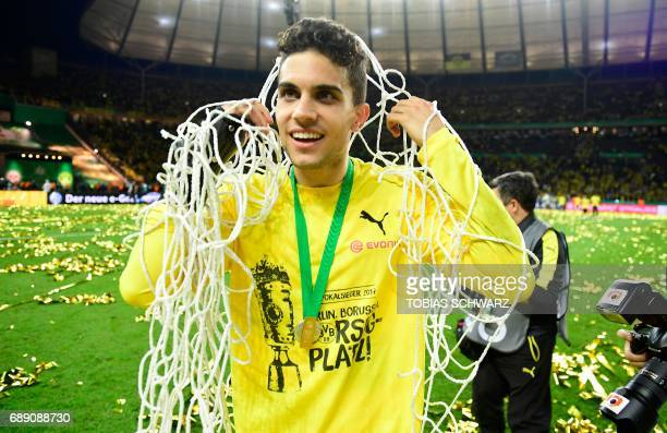 Dortmund's Spanish defender Marc Bartra holds the net after victory during the German Cup final football match Eintracht Frankfurt v BVB Borussia...
