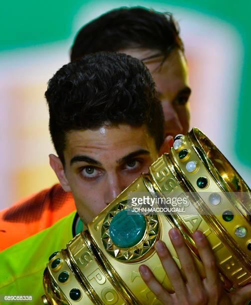 Dortmund's Spanish defender Marc Bartra kisses the trophy after the German Cup final football match Eintracht Frankfurt v BVB Borussia Dortmund at...