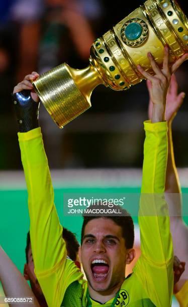 Dortmund's Spanish defender Marc Bartra lifts the trophy after the German Cup final football match Eintracht Frankfurt v BVB Borussia Dortmund at the...