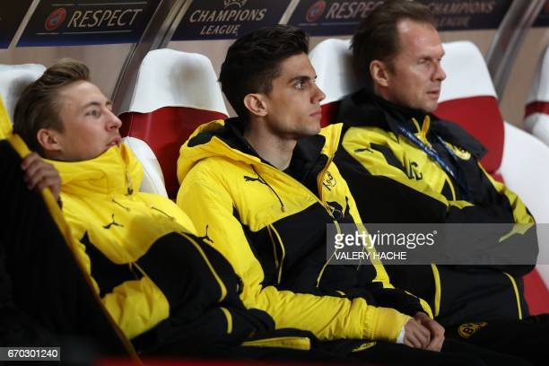 Dortmund's Spanish defender Marc Bartra looks on from the substitutes' bench prior to the UEFA Champions League football match AS Monaco vs Borussia...