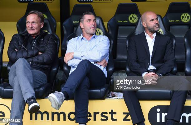 Dortmund's Sport director Michael Zorc CEO HansJoachim Watzke and Dortmund's Dutch head coach Peter Bosz are pictured prior to the German Supercup...