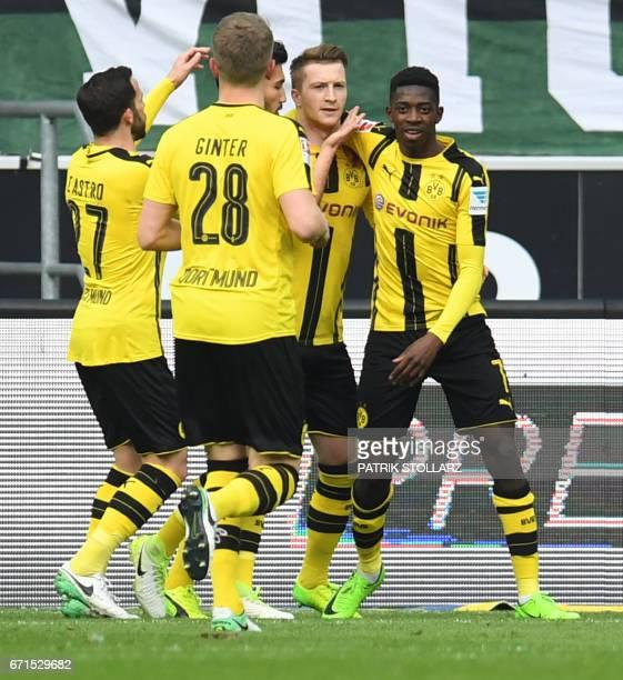 Dortmund's striker Marco Reus and his teammates celebrate scoring during the German first division Bundesliga football match Borussia...