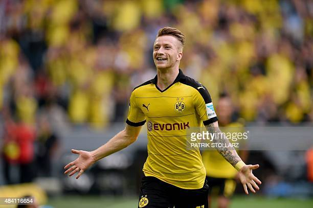 Dortmund's striker Marco Reus celebrates after scoring during the German first division Bundesliga football match Borussia Dortmund vs Borussia...