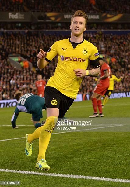 Dortmund's striker Marco Reus celebrates after scoring during the UEFA Europa league quarterfinal second leg football match between Liverpool and...