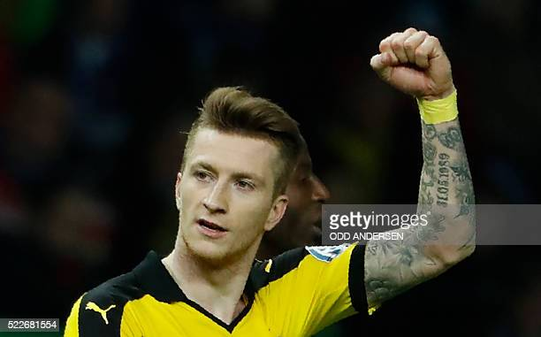 Dortmund's striker Marco Reus celebrates scoring the 02 goal during the German Cup semifinal football match Hertha Berlin v Borussia Dortmund at the...