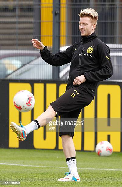 Dortmund's striker Marco Reus controls the ball during a training session during the media day for the Champions League final in Dortmund western...