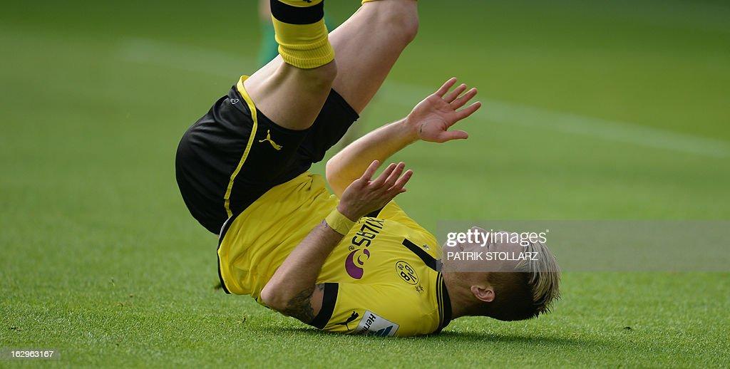 Dortmund's striker Marco Reus falls during the German first division Bundesliga football match Borussia Dortmund vs Hannover 96 in the German city of Dortmund on March 2, 2013.