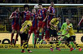 Dortmund's striker Marco Reus shoots a free kick towards the Bayern wall during the German first division Bundesliga football match Borussia Dortmund...