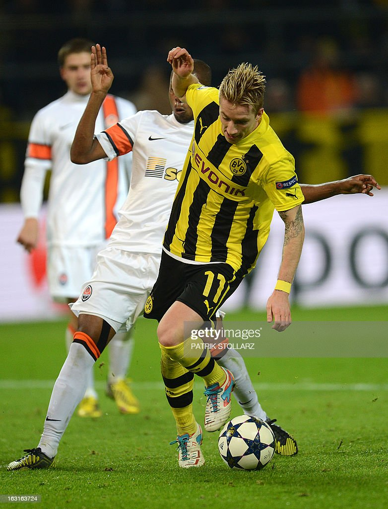 Dortmund's striker Marco Reus (R) vies for the ball during the UEFA Champions League last 16, second leg match Borussia Dortmund vs Shakhtar Donetsk in Dortmund, western Germany, on March 5, 2013.
