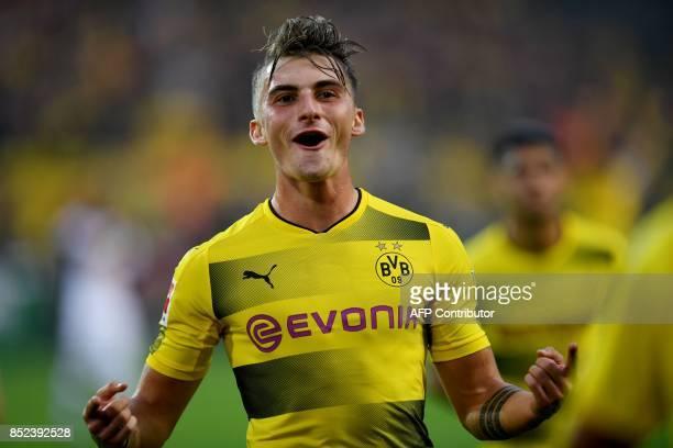 Dortmund's striker Maximilian Philipp celebrates scoring during the German First division Bundesliga football match Borussia Dortmund vs Borussia...