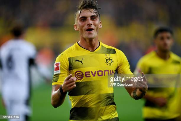 Dortmund's striker Maximilian Philipp celebrates scoring with his teammates during the German First division Bundesliga football match Borussia...