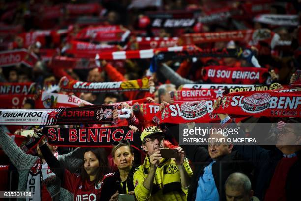 A Dortmund's supporter takes pictures moments before the UEFA Champions League round of 16 first leg football match SL Benfica vs Borussia Dortmund...