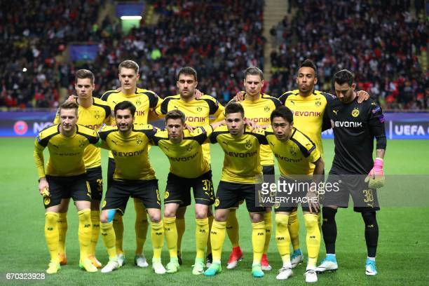 Dortmund's Swiss goalkeeper Roman Buerki Dortmund's Turkish midfielder Nuri Sahin Dortmund's forward Marco Reus Dortmund's Portuguese defender...