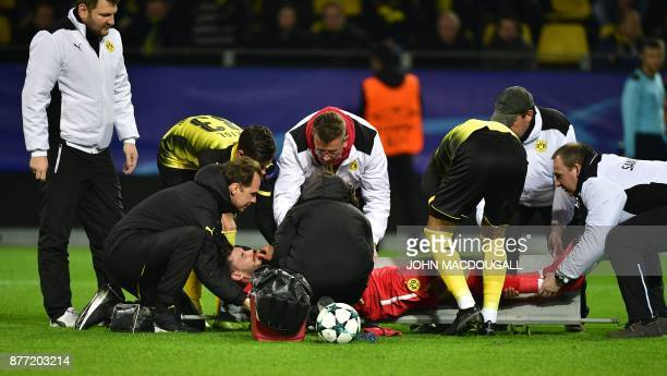 TOPSHOT Dortmund's Swiss goalkeeper Roman Buerki is stretchered off by medical staff during the UEFA Champions League Group H football match BVB...
