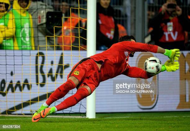 Dortmund's Swiss goalkeeper Roman Buerki makes a save during the penalty shootout of the German Cup DFB Pokal round of 16 football match BVB Borussia...