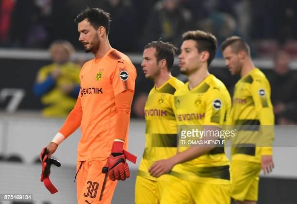 Dortmund's Swiss goalkeeper Roman Buerki midfielder Mario Goetze Portuguese defender Raphael Guerreiro and Ukrainian forward Andrey Yarmolenko react...