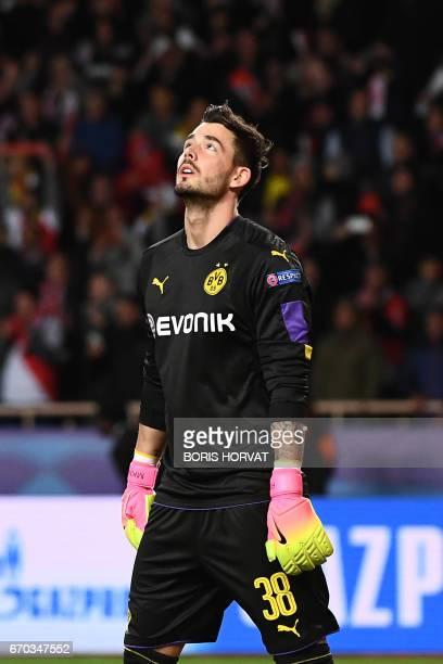 Dortmund's Swiss goalkeeper Roman Buerki reacts after Monaco defeated Dortmund during the UEFA Champions League 2nd leg quarterfinal football match...