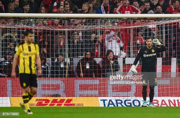 Dortmund's Swiss goalkeeper Roman Buerki reacts after the second goal for Munich during the German Cup DFB Pokal semifinal football match between FC...