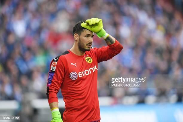 Dortmund's Swiss goalkeeper Roman Buerki reacts during the German First division Bundesliga football match between FC Schalke 04 and Borussia...