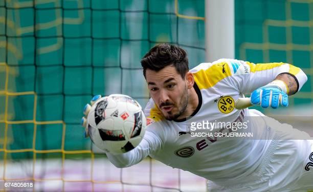 Dortmund's Swiss goalkeeper Roman Buerki saves the ball during the German first division Bundesliga football match between Borussia Dortmund and FC...