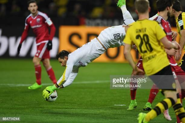 Dortmund's Swiss goalkeeper Roman Buerki vies for the ball during the German First division Bundesliga football match BVB Borussia Dortmund vs FC...