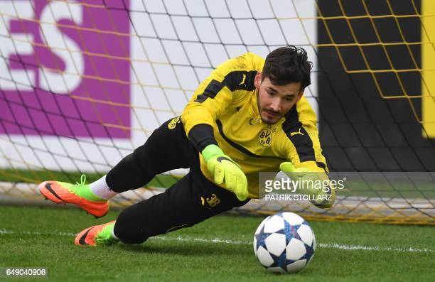 Dortmund's Swiss goalkeeper Roman Buerki warms up during a training session in Dortmund on March 7 2017 on the eve of the Champions League football...